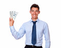 Stylish young man holding cash dolllars portrait of a dollars on isolated background Royalty Free Stock Photos