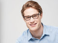 Stylish young man wearing a glasses handsome looking at camera Royalty Free Stock Photos