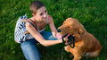 Stylish young woman and her pet dog golden retriever. Royalty Free Stock Photo