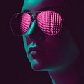 Stylish young woman in sunglasses with pink lens Royalty Free Stock Photo