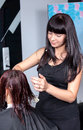 Stylist cutting woman hair in salon Royalty Free Stock Photo