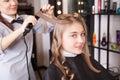 Stylist make curls hair in salon portrait of making Stock Photos