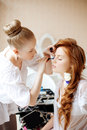 Stylist makes makeup bride before the wedding on day Stock Photos