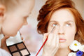 Stylist makes makeup bride on the wedding day Royalty Free Stock Photo