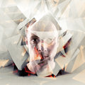 Stylized artistic young man portrait with chaotic polygons conceptual polygonal broken fragments Stock Image