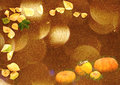 Stylized autumn background with leaves and pumpkins in golden tones soft focus blur bokeh Royalty Free Stock Images