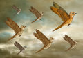 Stylized flock of birds illustration a flying through the heavens Stock Photo