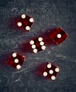 Stylized playing dice on dark background, shallow depth of field Royalty Free Stock Photo