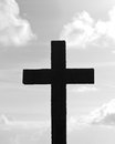 Stylized silhouette of a cross in black and white above the earth against the heavens Royalty Free Stock Photo
