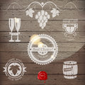 Stylized wine emblems on wooden background Royalty Free Stock Photos