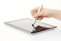 Stylus being used on tablet computer with Royalty Free Stock Photography