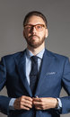 Suave handsome stylish bearded man in blue suit Royalty Free Stock Photo