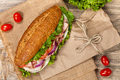 Sub sandwich homemade italian with salami tomato and lettuce selective focus Stock Image