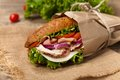 Sub sandwich homemade italian with salami tomato and lettuce selective focus Royalty Free Stock Photos