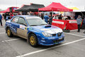 Subaru Impreza WRC in pit stop Royalty Free Stock Photography