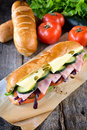 Submarine sandwich with cheese and ham selective focus on the front Royalty Free Stock Image