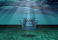 Submerged chair in submerged desert floats Royalty Free Stock Photography
