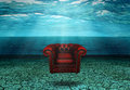 Submerged Chair in Submerged Desert Ruins Royalty Free Stock Photo