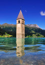 Submerged church tower reschensee lake south tyrol also known italian name lago di resia tower used to belong to town graun im Royalty Free Stock Photos