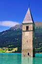 Submerged church tower reschensee lake south tyrol also known italian name lago di resia tower used to belong to town graun im Royalty Free Stock Image