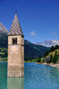 Submerged church tower reschensee lake south tyrol also known italian name lago di resia tower used to belong to town graun im Royalty Free Stock Images