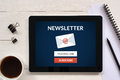 Subscribe newsletter concept on tablet screen with office object Royalty Free Stock Photo