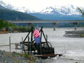 Subsistence salmon fishing in alaska a water wheel and bulldozers gathering at the copper river the springtime Royalty Free Stock Photos