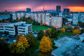 Suburb at sunset with school and trees Royalty Free Stock Images