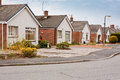 Suburban bungalows on housing estate row of modern a in suburbia Royalty Free Stock Photo