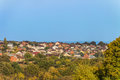 Suburban skyline. Buildings individual suburban housing in the green plants district. Royalty Free Stock Photo