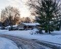 Suburban street on snowy morning snow covered in dawn light Stock Photos