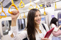 Subway commuter woman on tokyo public transport japanese girl or tourist using japan s capital city metro system to commute Royalty Free Stock Image