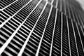 Subway grate closeup black and white close up of a sidewalk with shallow depth of field Stock Photo