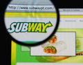 Subway photo of homepage on a monitor screen through a magnifying glass Royalty Free Stock Photos