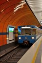 Subway train pulls into station munich germany november a blue colored a platform in the system along Stock Image