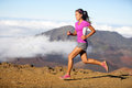 Succes runner woman athlete running sprinting fast female sport fitness model training a sprint in amazing nature landscape Stock Images