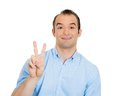 Succesfull man giving peace closeup portrait of happy excited successful young victory or two sign isolated on white background Royalty Free Stock Photography