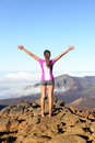 Success and achievement hiking woman on top of the world happy cheering in winning gesture excited having reached summit of Royalty Free Stock Image