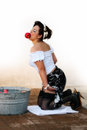 Success beautiful pin up girl successful at bobbing for apples Stock Image