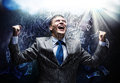 Success in business cheerful businessman with hands up celebrating Royalty Free Stock Photos