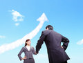 Success business concept woman and man handshake with arrow cloud sky in the background asian hong kong Royalty Free Stock Photography