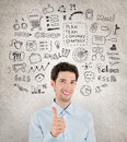 Success business management concept image of successful handsome businessman with lot of hand drawn icons around which symbolizing Stock Photos
