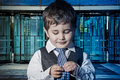 Success child dressed businessman with hands in his tie and skys Stock Photography