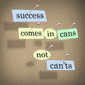 Success comes in cans not can ts positive attitude saying on paper pieces pinned to a cork board a motivational message meant to Stock Image