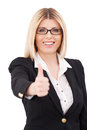 Success confident mature businesswoman showing her thumb up and smiling while standing isolated on white Stock Image