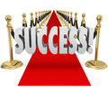 Success d word red carpet vip exclusive entrance arrival in letters on a within black velvet ropes to illustrate a grand or at an Stock Photos