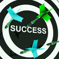 Success on dartboard shows unsuccessful goals or incomplete jobs Stock Photo