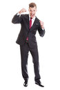 Success full length portrait of a young businessman enjoying the isolated on white Royalty Free Stock Photo