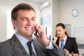 Success happily smiling men talking on the phone Stock Photo