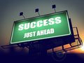Success just ahead on green billboard the rising sun background Stock Photography